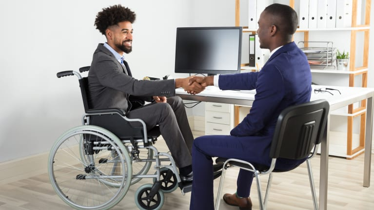 person in wheelchair accepting job