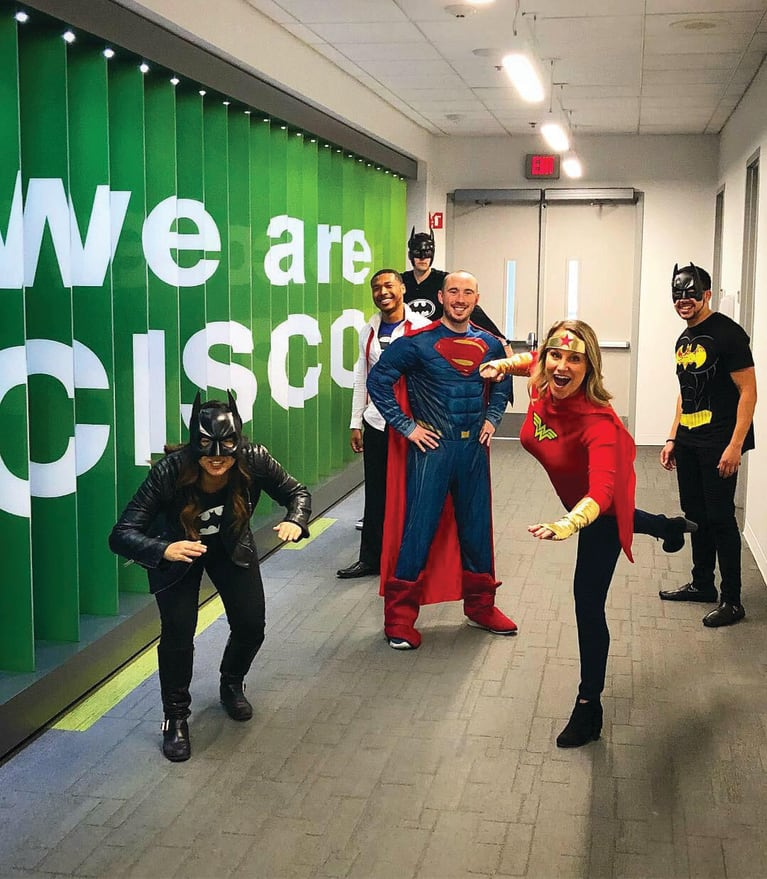 Cisco customer success managers in the company's Raleigh, N.C., office have some fun impersonating superheroes in this photo, a