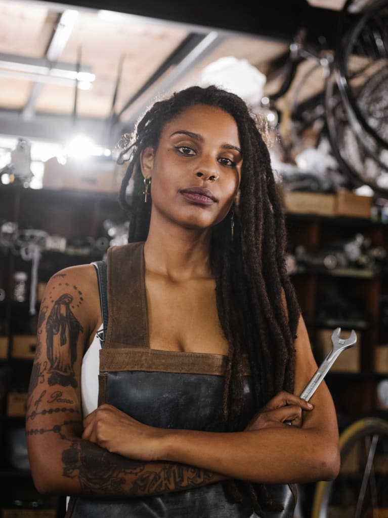 Photo of woman with tattoos on her arms.