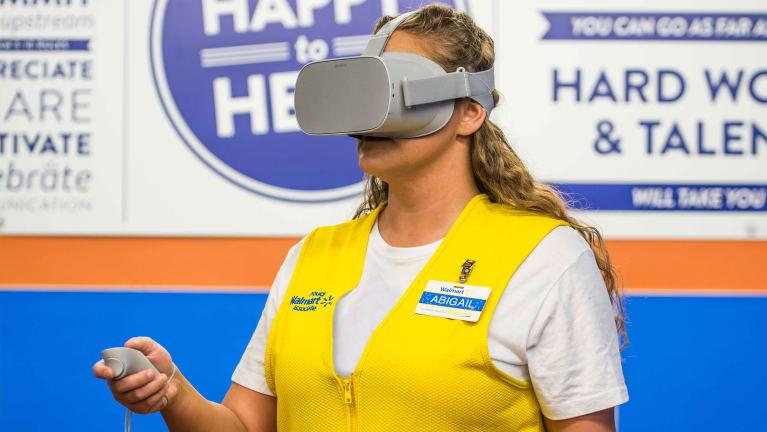 A Walmart employee uses virtual reality (VR) technology in a corporate upskilling training program.