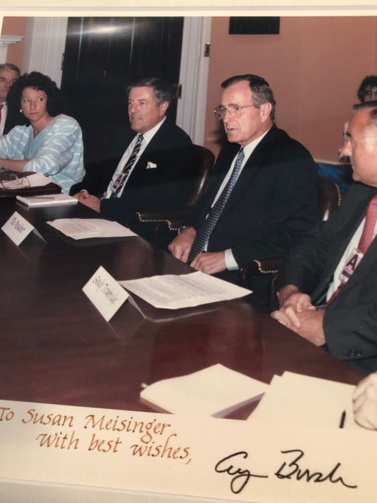 Former SHRM President & CEO Susan Messinger, far left, discusses the ADA legislation with President Bush.
