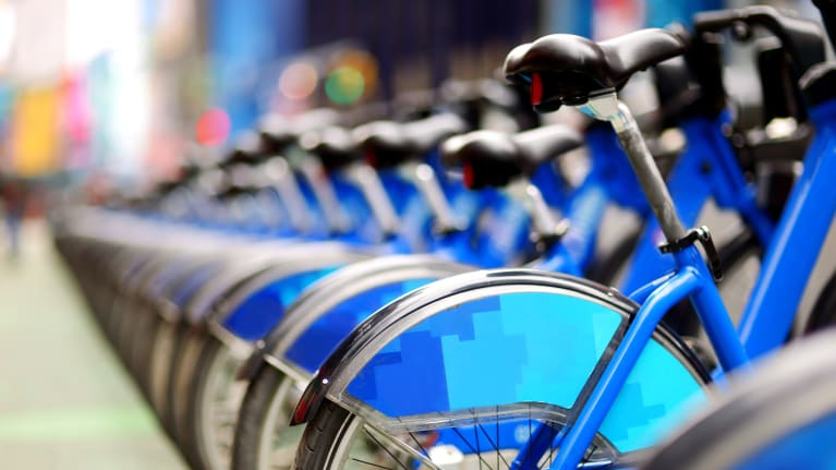 Should Employers Cover Bike-Share and Electric-Scooter Rentals?