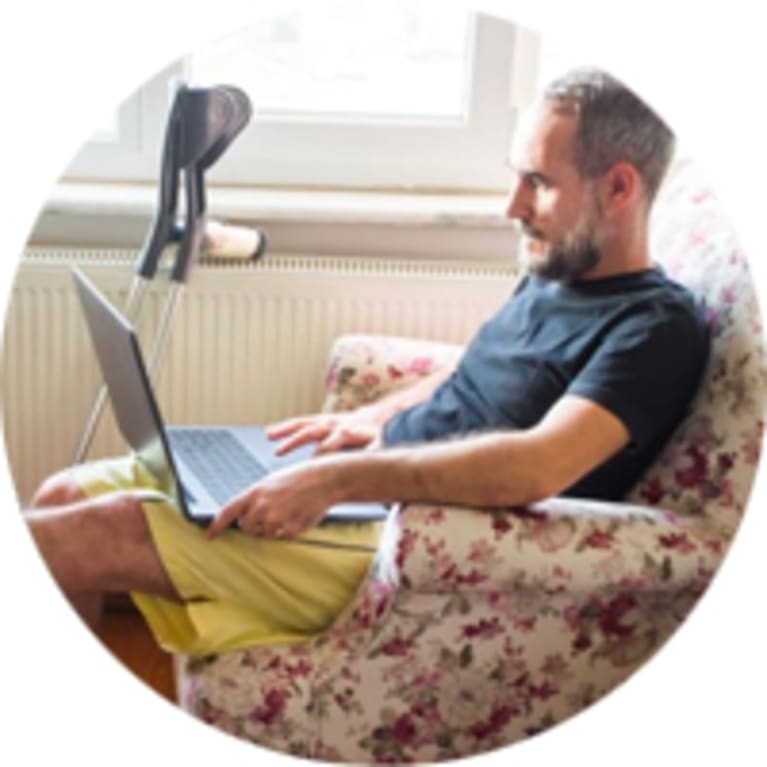 injured man working from home