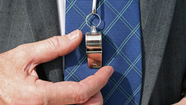close up of businessman with whistle