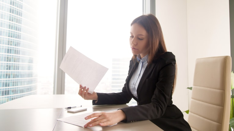 businesswoman reviewing documents