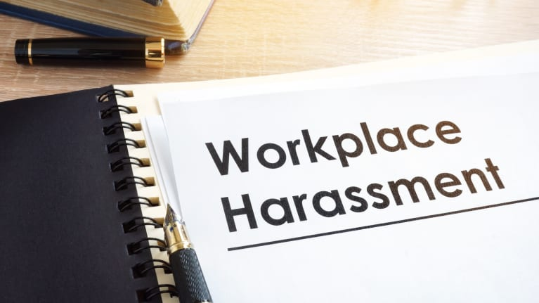 Workplace harassment written on a sheet of paper in boldface