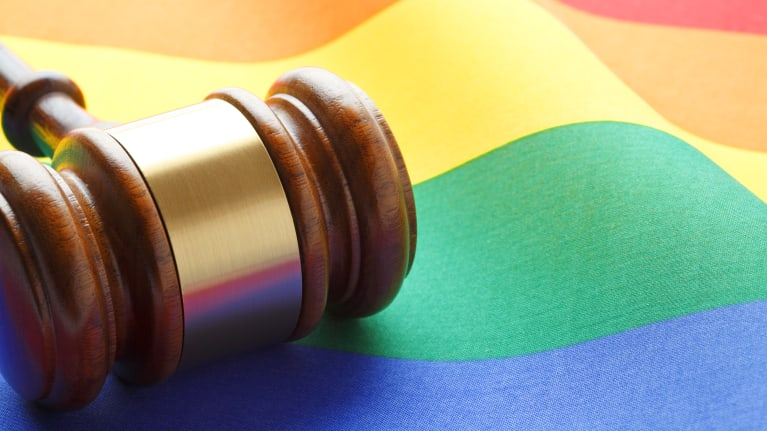 gavel and rainbow flag