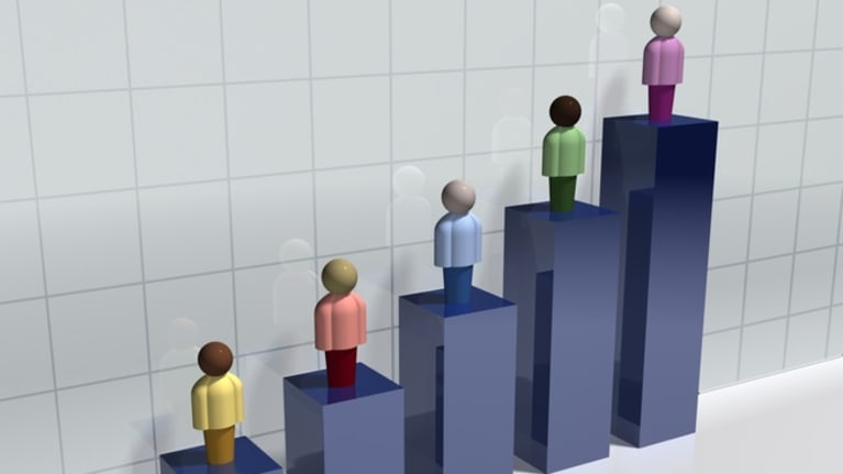 illustration of diverse employee figures standing on bar chart bars