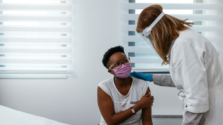 A medical professional with a vaccinated patient