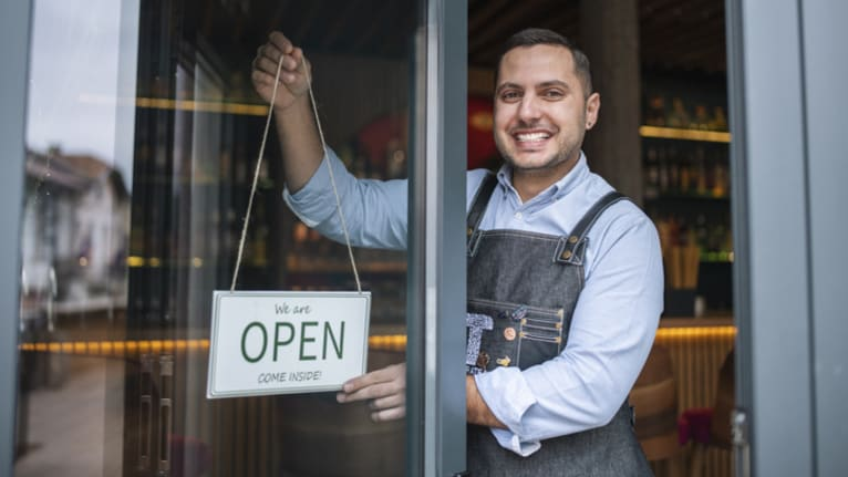 man opening shop