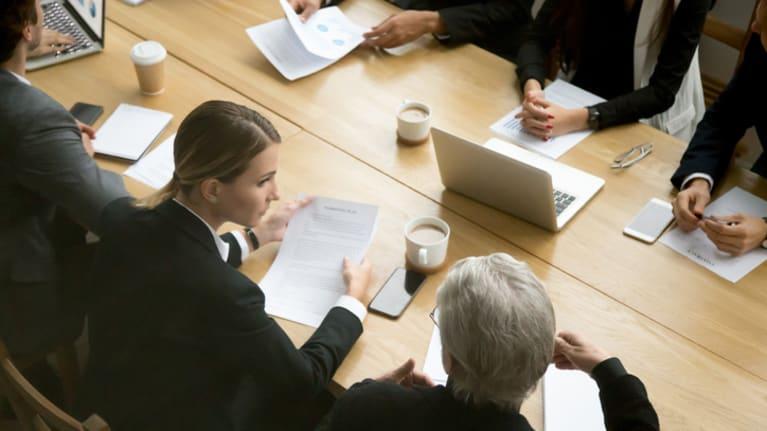 people around negotiation table