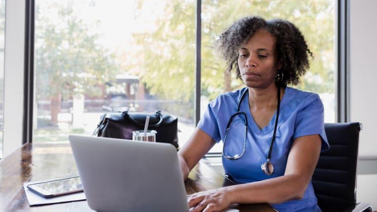 nurse on laptop