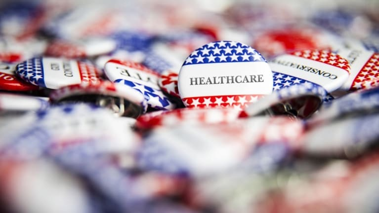Campaign buttons that say healthcare.