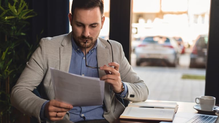 man reading file