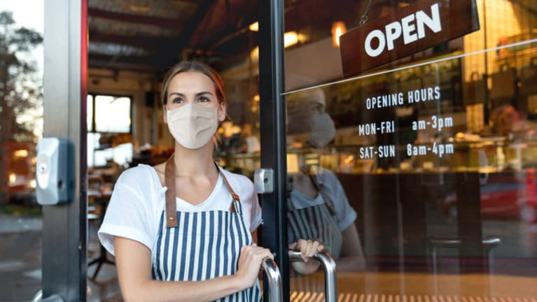 woman opening cafe