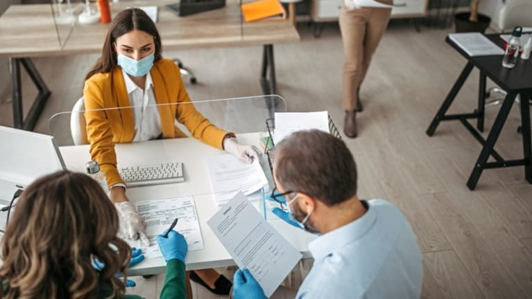 Filing out employment forms, wearing surgical masks.