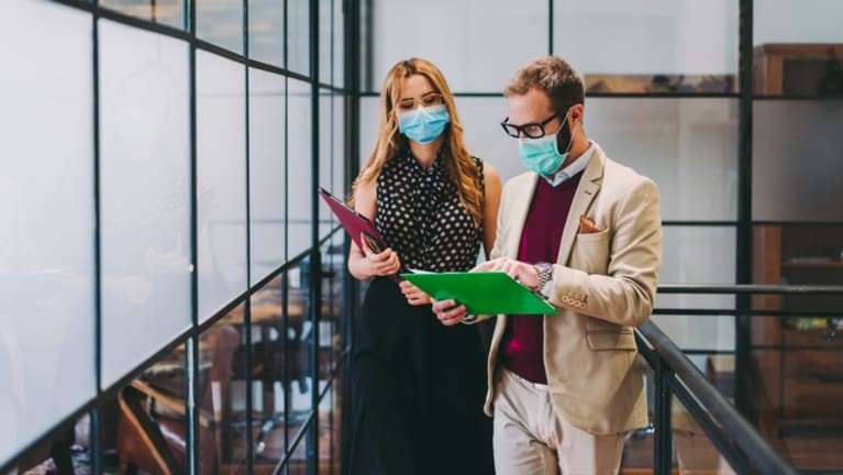 office workers wearing surgical masks