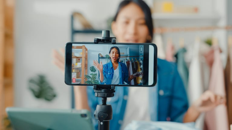 girl recording video with phone