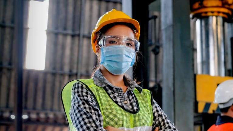 worker wearing mask, goggles and hard hat