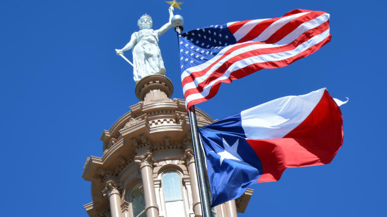 Texas Capitol with American and Texas Flags