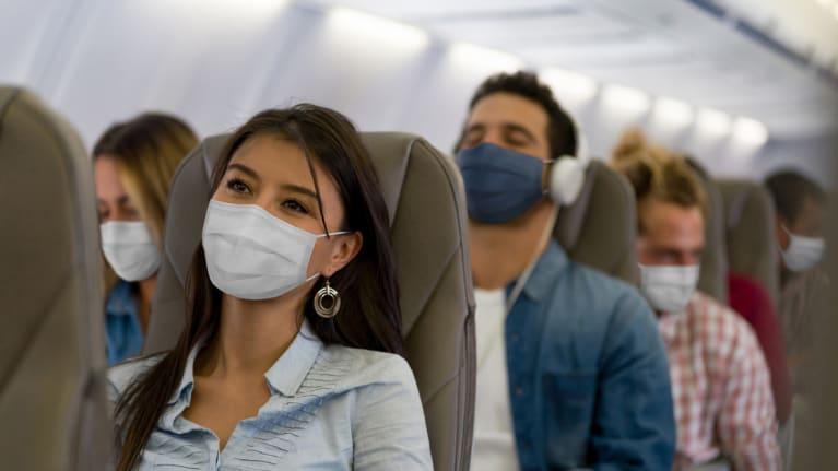airline passengers wearing masks