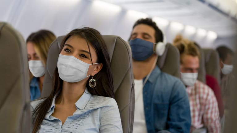 masked airline passengers