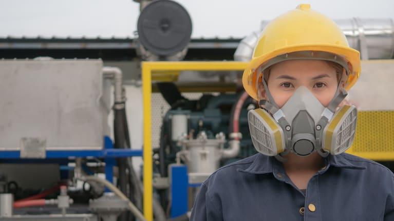 worker wearing a respirator