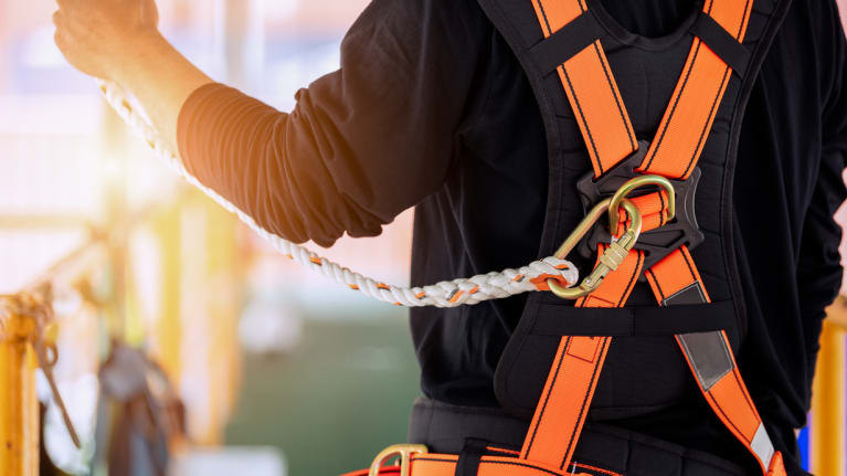construction worker wearing a safety harness