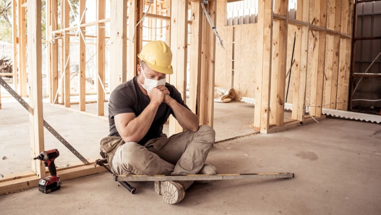 construction worker wearing mask on worksite