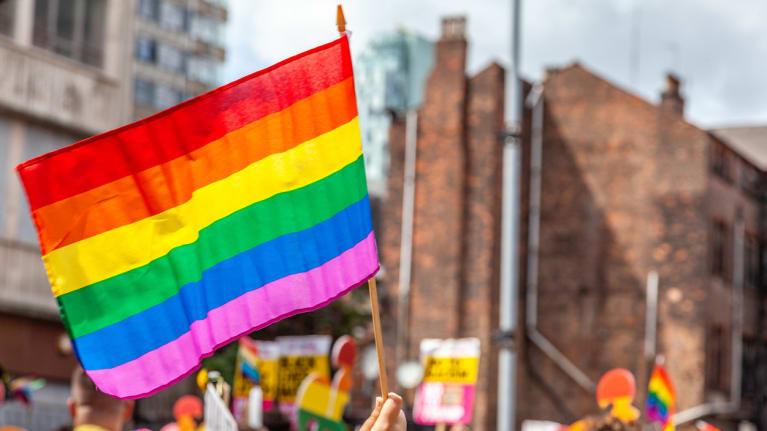 a rainbow flag at a rally