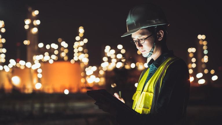 engineer using digital tablet working late night shift