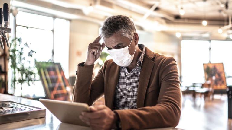 man wearing mask at work