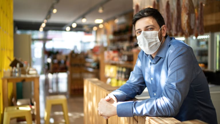 small business man wearing face mask
