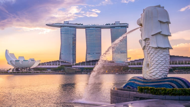 modern building in Singapore with fountain in the foreground