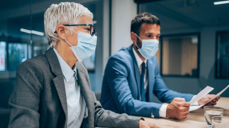 emerging professionals wearing masks