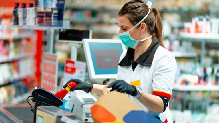 cashier with facemask and gloves