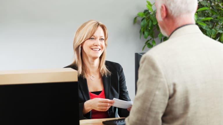 Bank Teller Serving Customer