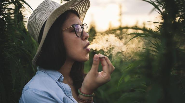 Woman Smoking Marijuana In Field