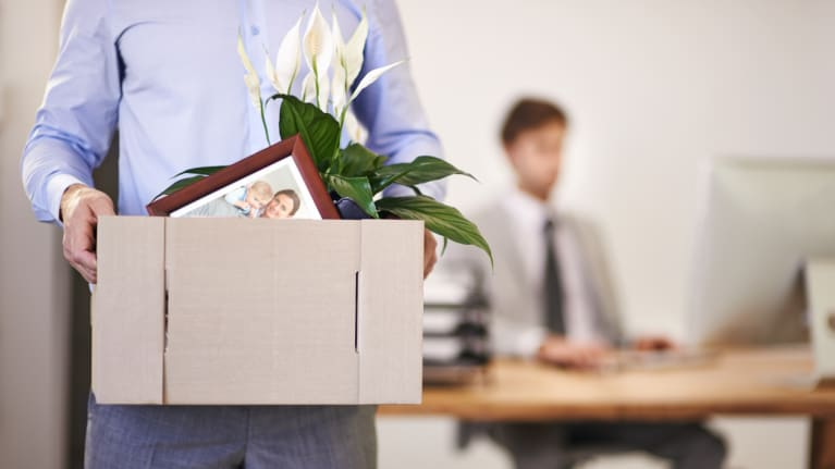 laid-off worker caring box of personal belongings