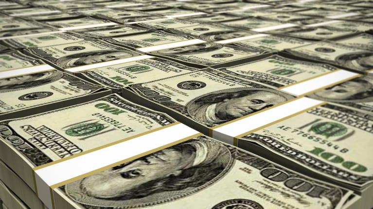 stacks of 100 dollar bills