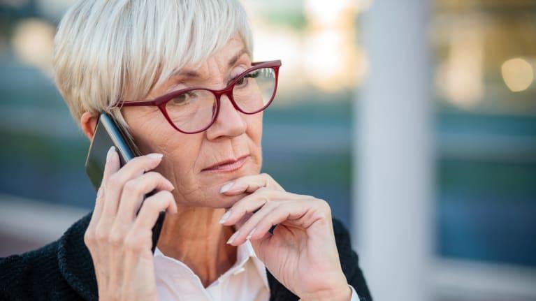 an older businesswoman on her cellphone