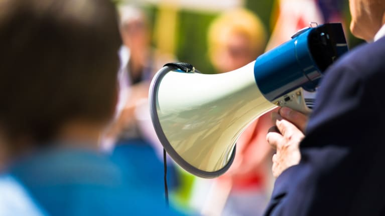 someone speaking on a bullhorn