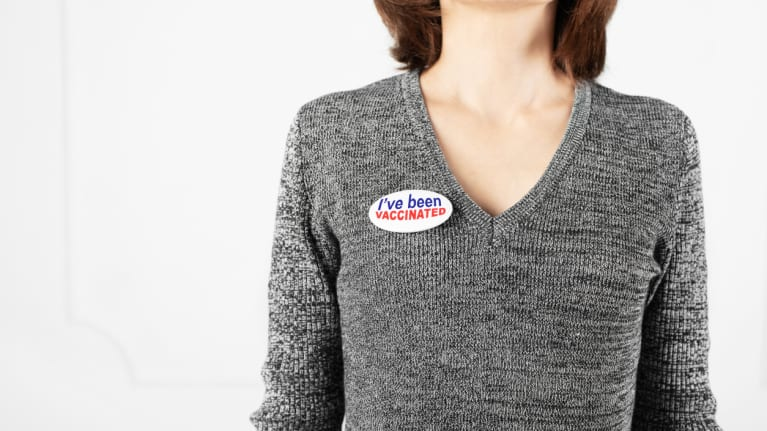 a woman wearing an I've been vaccinated button