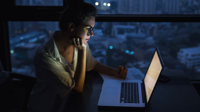 professional woman working late at computer