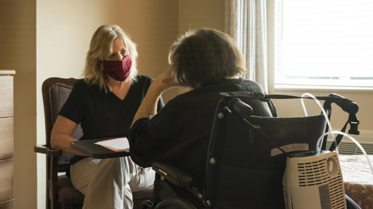 two women in retirement home, in face masks