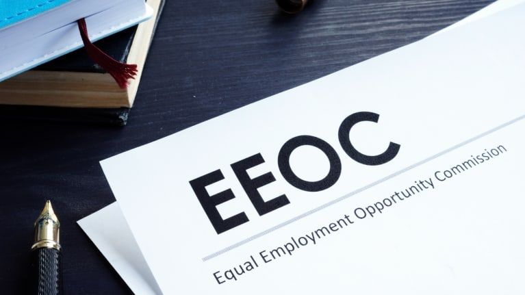 EEOC letterhead and a pen