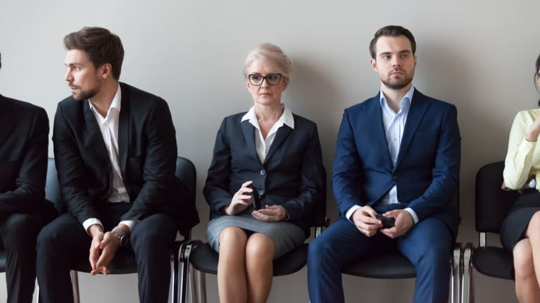 young and mature workers waiting for job interview