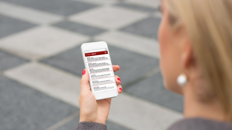 business woman checking email on smartphone