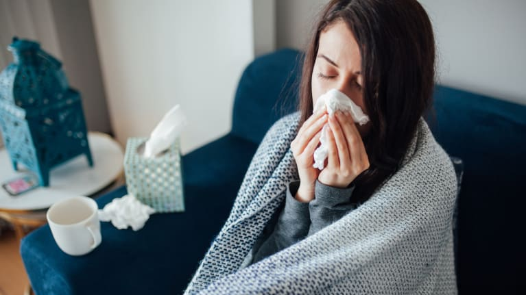 woman sick at home