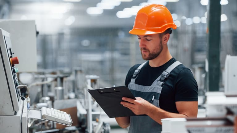 man at factory wearing hard hat